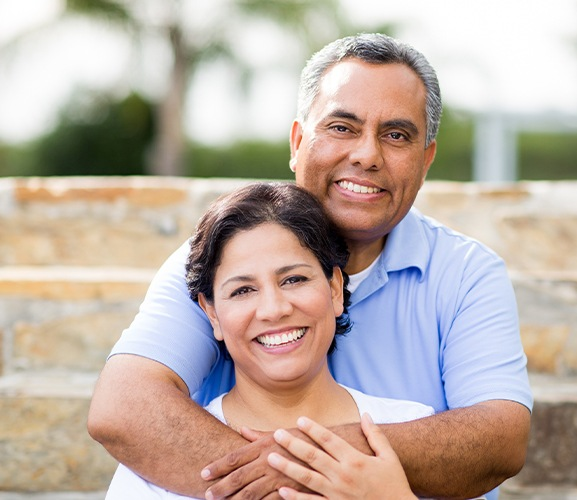 Man and woman with dental bridge restorations